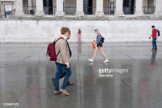 Scenes of a very quiet Trafalgar Square after a rain shower under coronavirus lockdown on 1st July 2020 in London, England, United Kingdom. As the...