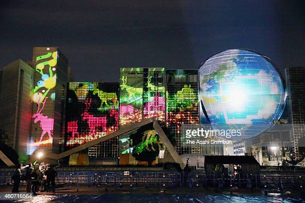 Scenes of Christmas are projected on the wall of Nagoya City Science Museum and its planetarium dome during the test lighting of the 'Brother Green...