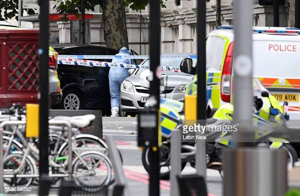 A scenes of crime officer enters a vehicle which is believed to be the car that mounted the pavement and collided with pedestrians outside the...