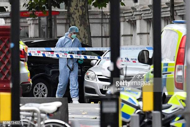 A scenes of crime officer works inside a police cordon after a car mounted the pavement and collided with pedestrians outside the Natural History...