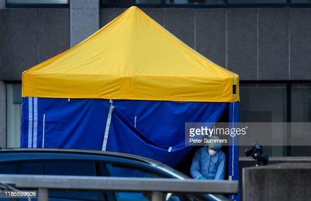 A scenes of crime officer works under a forensics tent at the scene of yesterday's London Bridge stabbing attack on November 30 2019 in London...