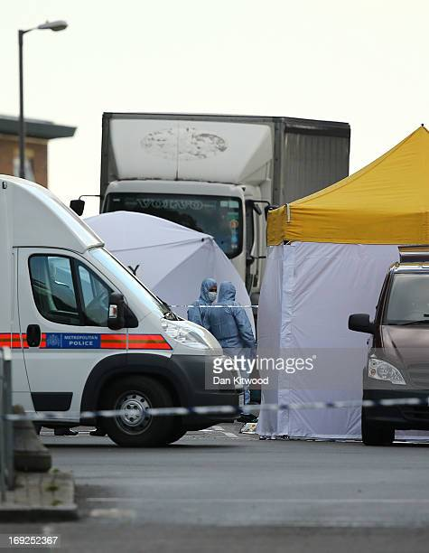 Scenes of Crime Officers at the scene in Woolwich following a major incident in which a man was killed on May 22 2013 in London England It has been...