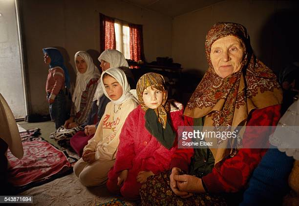 Scenes of daily life inside a Croatian refugee camp in Resnic Muslim women pray in an improvised mosque | Location Resnic Croatia