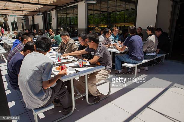 Scenes of daily work and life at Facebook Inc USA Headquarters in Menlo Park California Employees eat outside the Epic Cafe