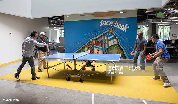Scenes of daily work and life at Facebook , Inc. USA Headquarters in Menlo Park, California. Facebook employees relax with a game of ping-pong on...