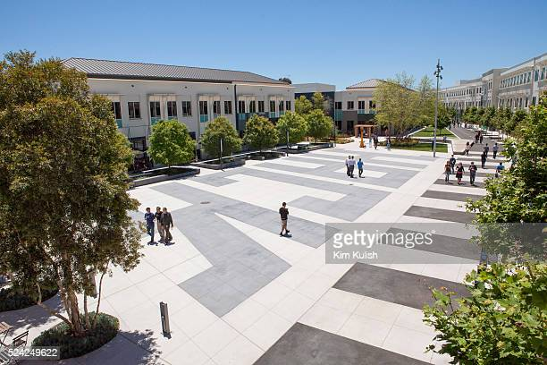 Scenes of daily work and life at Facebook, Inc. USA Headquarters in Menlo Park, California. Facebook employees and visitors walk along the main...