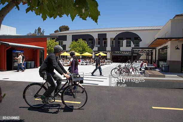 Scenes of daily work and life at Facebook, Inc. USA Headquarters in Menlo Park, California. Facebook employees ride Facebook bikes to get around...