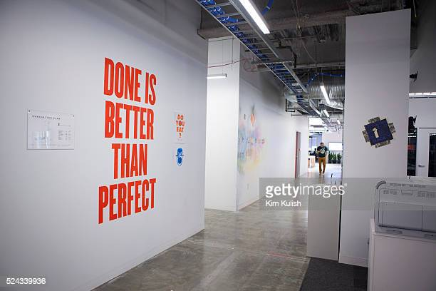 Scenes of daily work and life at Facebook Inc USA Headquarters in Menlo Park California Inspirational signs and posters are on the walls and...