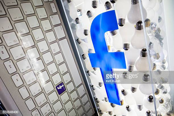 Scenes of daily work and life at Facebook, Inc. USA Headquarters in Menlo Park, California. A Facebook logo is illuminated on a lightbulb sculpture...