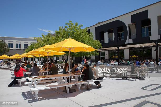 Scenes of daily work and life at Facebook , Inc. USA Headquarters in Menlo Park, California. Employees eat outside the Epic Cafe.