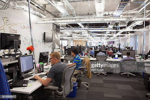 Scenes of daily work and life at Facebook Inc USA Headquarters in Menlo Park California View of employees at work in a typical unfinished looking...