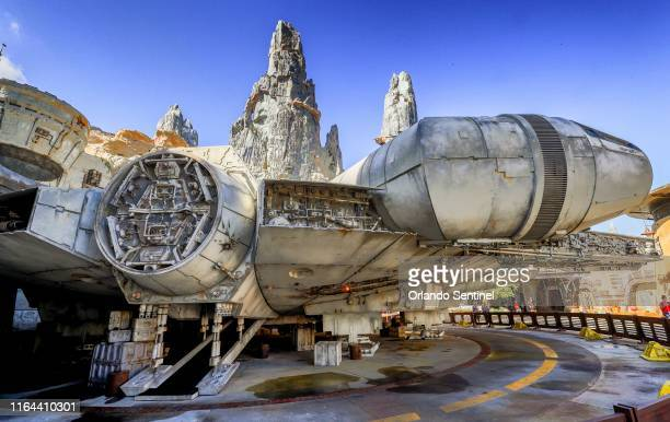 Scenes of the Millennium Falcon at Black Spire Outpost during a sneak peek for invited guests of the Star Wars: Galaxys Edge attraction at Disneys...