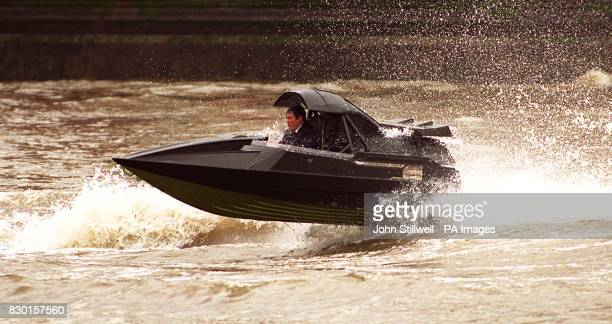 Scene's on the River Thames in Central London where Pierce Brosnan's stunt double films for the new Bond movie 'The World Is Not Enough' * a speeboat...