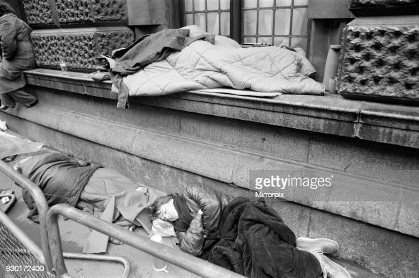 Scenes outside the Old Bailey during the Peter Sutcliffe, Yorkshire Ripper, trial. Pictured, sleeping through to dawn - the queue for the public...