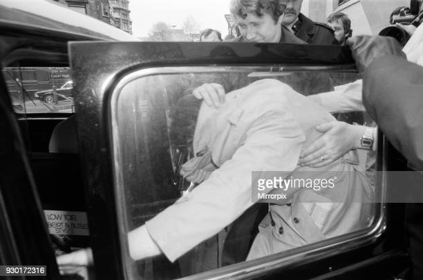 Scenes outside the Old Bailey during the trial of Peter Sutcliffe, the Yorkshire Ripper. Reporters bundle Trevor Birdsall into a taxi at the Old...