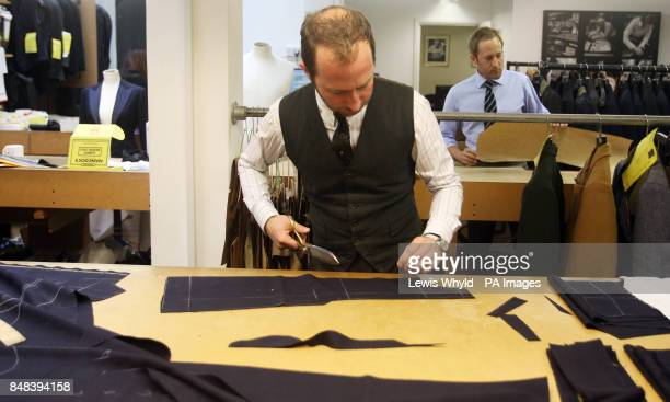 Scenes Tailors at work in the London Savile Row tailors Gieves Hawkes