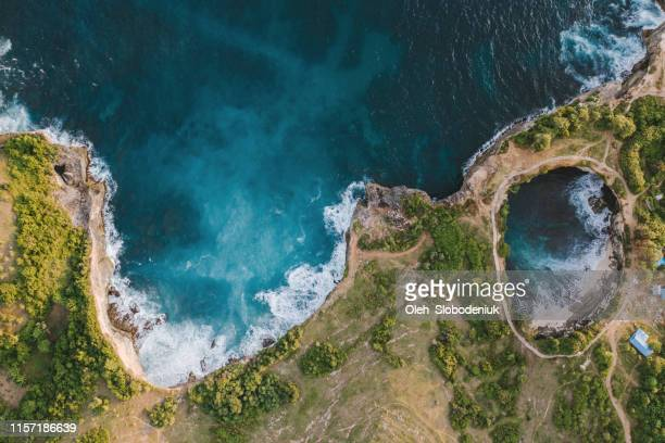 scenic aerial view of broken beach on nusa penida - geology stock pictures, royalty-free photos & images