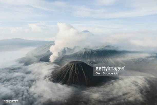 scenic aerial view of bromo volcano erupting - volcanic crater stock pictures, royalty-free photos & images