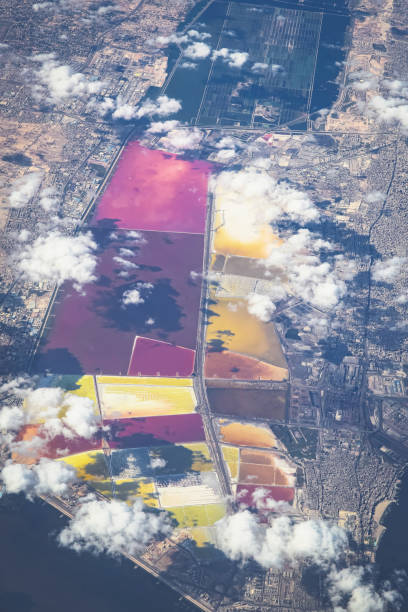 Scenic aerial view of colorful salt storage ponds seen from airplane near Cairo, Egypt
