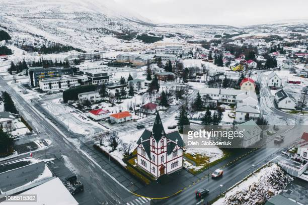 scenic aerial view of husavik town in winter - husavik stock photos and pictures