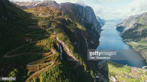 scenic aerial view of lysefjorden and winding road - norway stock pictures, royalty-free photos & images