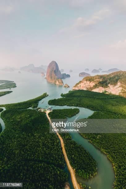 scenic aerial view of phang nga at sunrise - alba foto e immagini stock