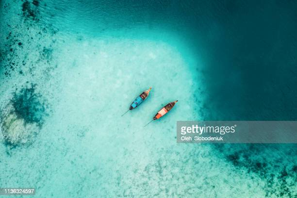 scenic aerial view of two boats on sea in thailand - landscape scenery stock pictures, royalty-free photos & images