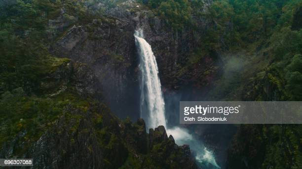 scenic aerial view of voringfossen waterfall - waterfall stock pictures, royalty-free photos & images