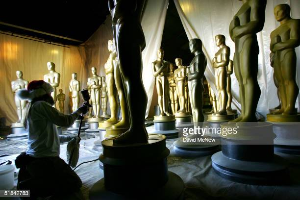Scenic artist works on an Oscar statue during the annual refurbishing of the props in preparation for the 77th Academy Awards December 9 2004 in...
