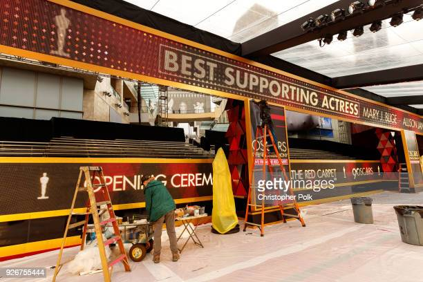 Scenic Artists Dena D'Angelo and Virginia Belloni prepare the red carpet as preperations continue for this years 90th Oscars on March 2 2018 in...