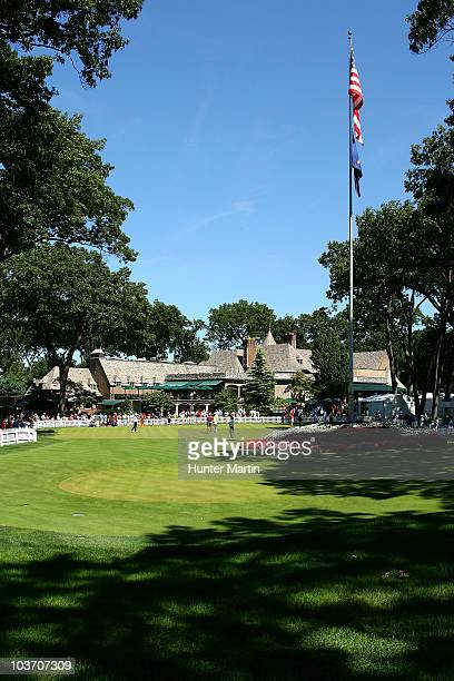 A scenic general view of players practicing on the putting green in front of the clubhouse during the final round of The Barclays at the Ridgewood...