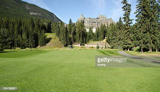 Scenic grass and mountains at Banff Gold Course and hotel.