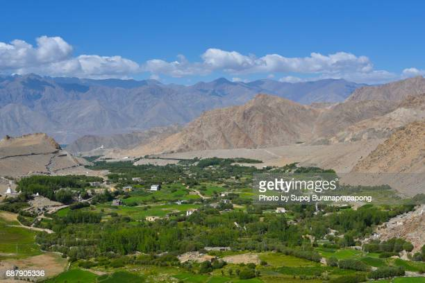 scenic high angle view of leh ladakh city from the mountain peak viewpoint on the way to nubra valley - kashmir valley stock photos and pictures