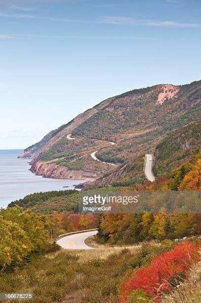 scenic highway along the sea - cape breton island stock pictures, royalty-free photos & images