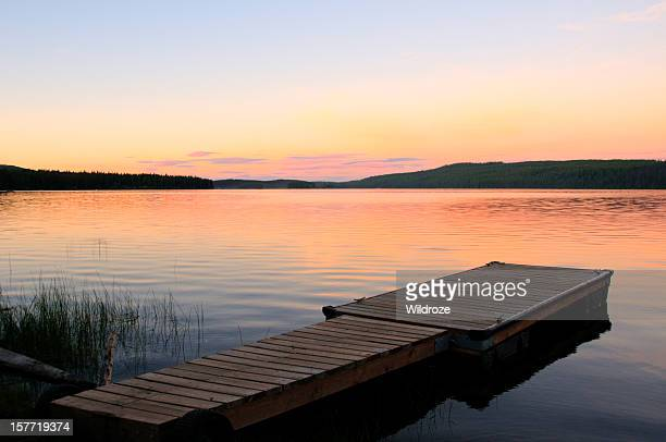 scenic lake and dock at sunset - kelowna stock pictures, royalty-free photos & images