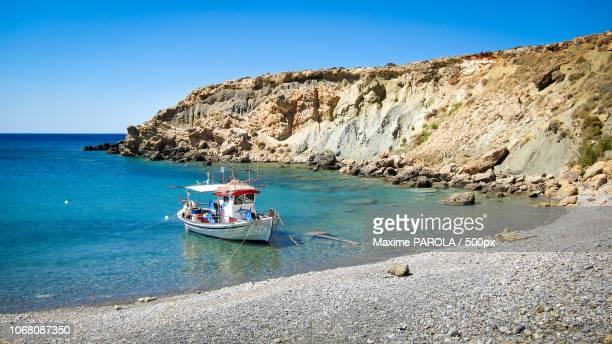 scenic landscape with moored boat, crete, greece - creta fotografías e imágenes de stock