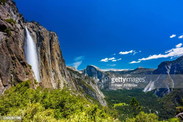 scenic landscape with mountains and forest - yosemite nationalpark stock pictures, royalty-free photos & images