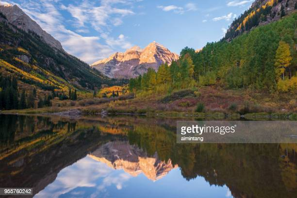 scenic mountain peaks and lake at maroon bells scenic area - maroon bells stock photos and pictures