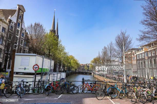 Scenic of Bike Bicycle lining on the bridge over canal Amsterdam in The Netherlands with traditional houses over the water and Amsterdam canal The...