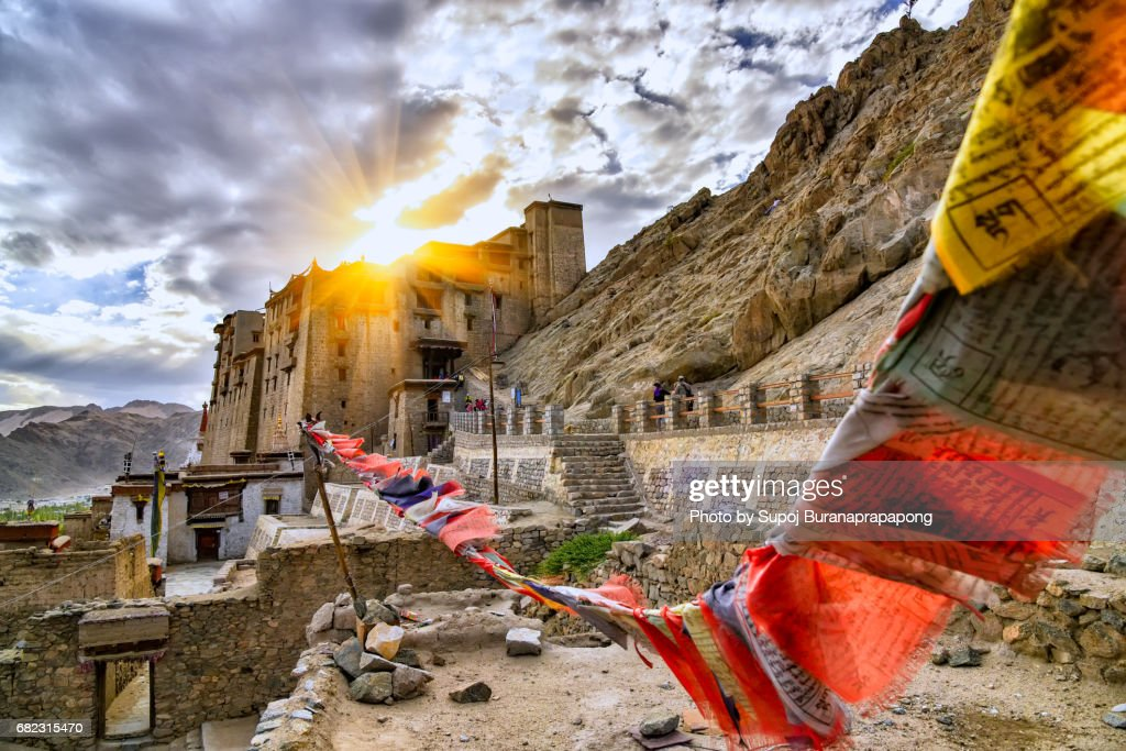 Scenic of leh palace with colorful omani prayer flag with dramatic sky in leh ladakh,india : Stock Photo