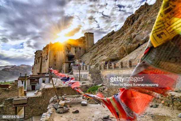 Scenic of leh palace with colorful omani prayer flag with dramatic sky in leh ladakh,india