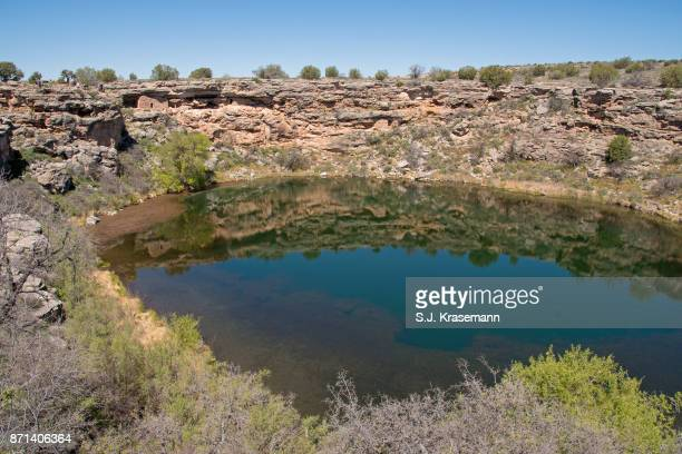 scenic of montezuma well and ancient cliff dwellings. - sinagua stock pictures, royalty-free photos & images