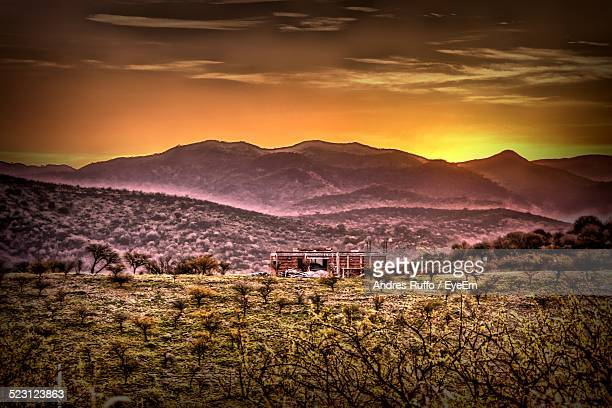 scenic of mountains against orange sky - andres ruffo bildbanksfoton och bilder