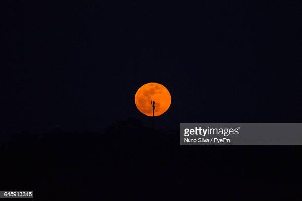 Scenic Of Orange Full Moon Against Clear Sky At Night