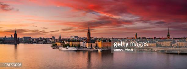 scenic panoramic view of gamla stan, in the old town in stockholm at sunset, sweden - stockholm stock pictures, royalty-free photos & images