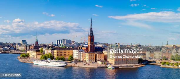 scenic panoramic view of gamla stan or old town in summer at stockholm, sweden - nobel prize stock pictures, royalty-free photos & images