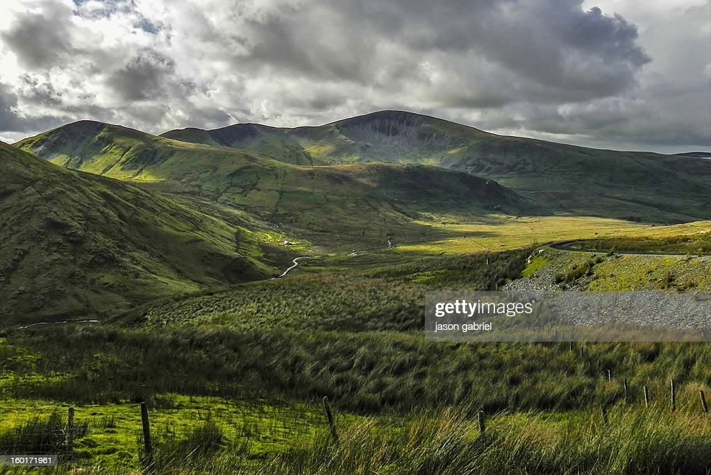 CONTENT] A scenic picture of rain clouds coming in over the Snowdon Valley