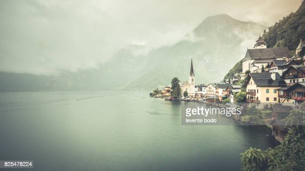 Scenic picture-postcard view of famous Hallstatt lakeside town in the Austrian Alps in beautiful morning light at sunrise on a sunny day in summer, Salzkammergut region, Austria