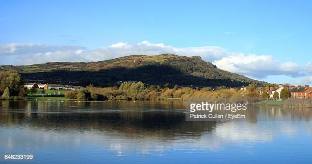 Scenic Reflection Of Landscape And Clouds In Lake