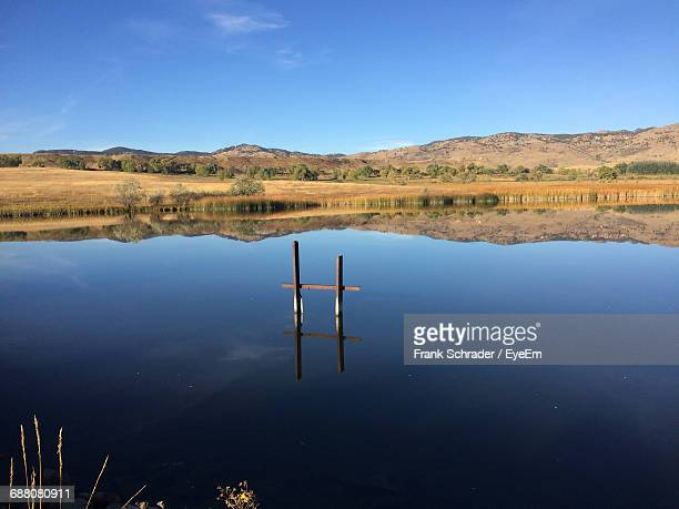 scenic reflection of landscape in calm lake - frank schrader stock pictures, royalty-free photos & images
